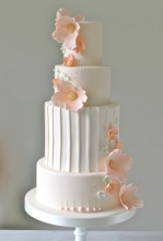 Pleats & Coral Wedding Cake